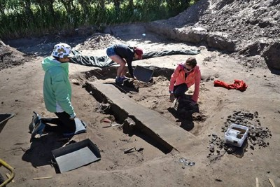 Harvard students Jessica Ding '19 (from left), Andie Turner '20, and Maile Sapp '17 work at the dig site on the Danish island of Samsø as part of an immersive summer program on the Vikings