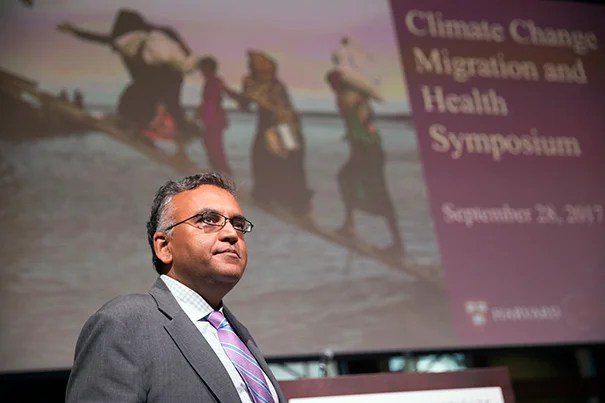 Ashish Jha gives welcoming remarks during the Harvard Global Health Institute symposium on Climate Change, Migration and Health, inside the Knafel Center (Radcliffe Gym).