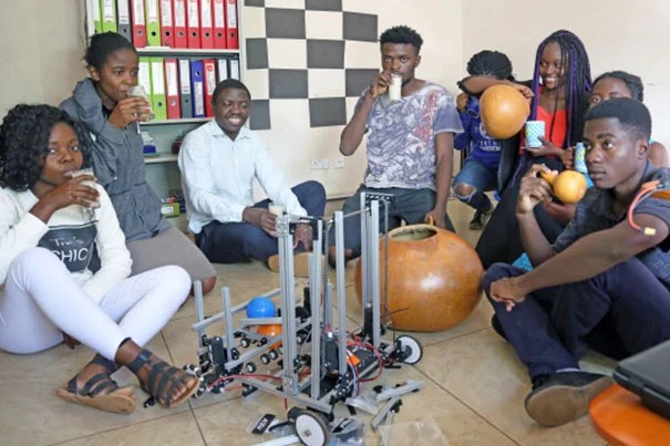 Students on the Zambian FIRST Global robotics team take a much-deserved break while working to finish construction of their robot. Photo courtesy of Sela Kasepa