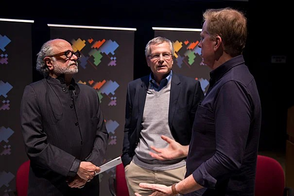 Tom Ashbrook (right), host of NPR's On Point, talks with Harvard professors Homi Bhabha (from left) and Dani Rodrik following a Worldwide Week forum on global citizenship and globalization.