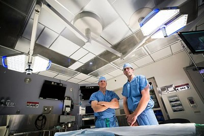 MGH physicians Allan Goldstein (left) and Brian Cummings were faced with ethical and surgical challenges when they separated conjoined twins.