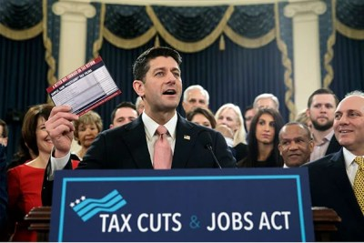 "Speaker of the House Paul Ryan, R-Wis., with House Majority Whip Steve Scalise, R-La., far right, holds a proposed ""postcard tax filing form"" as they unveil the GOP's far-reaching tax overhaul, the first major revamp of the tax system in three decades, on Capitol Hill in Washington, Thursday, Nov. 2, 2017."