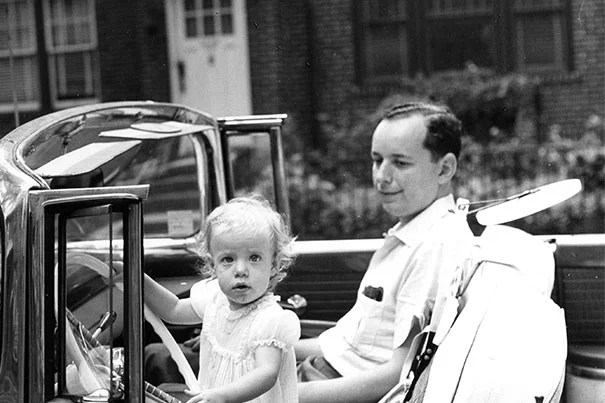 """Susan Faludi in her father's car in New York City, early 1960s. Faludi, who wrote about her gender-transitioned father, is among the panelists at the Schlesinger Library's """"Hidden in Plain Sight: Family Secrets and American History."""""""