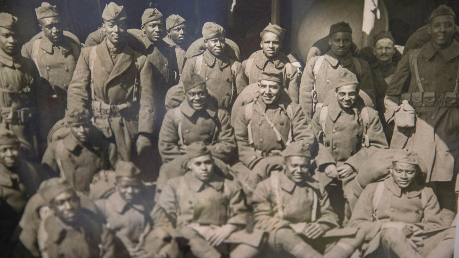 African-American soldiers fighting in WWI pose for a company photo.  Kris Snibbe/Harvard Staff Photographer