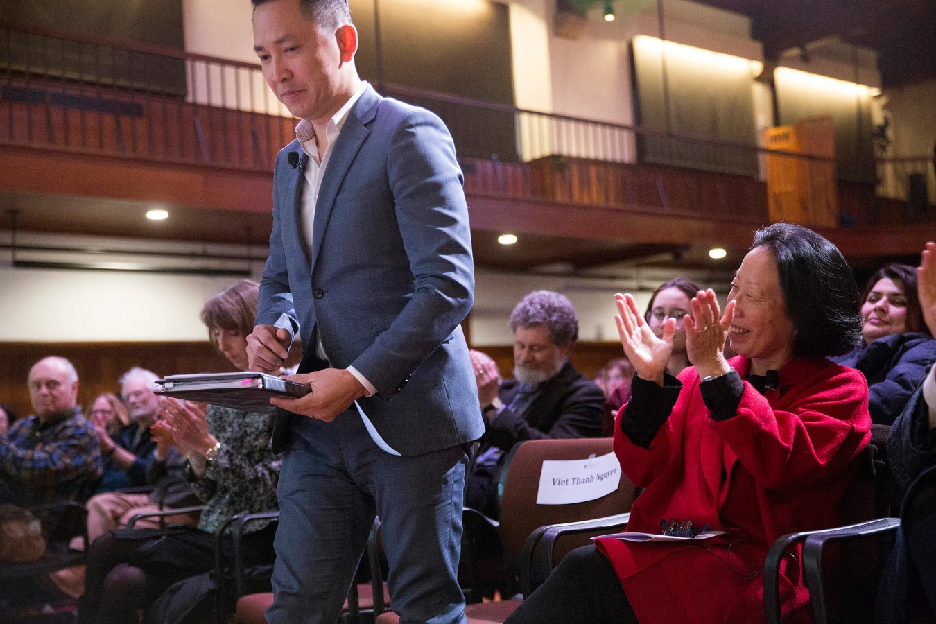 Gish Jen (right) applauds Nguyen as he takes the stage. Jon Chase/Harvard Staff Photographer