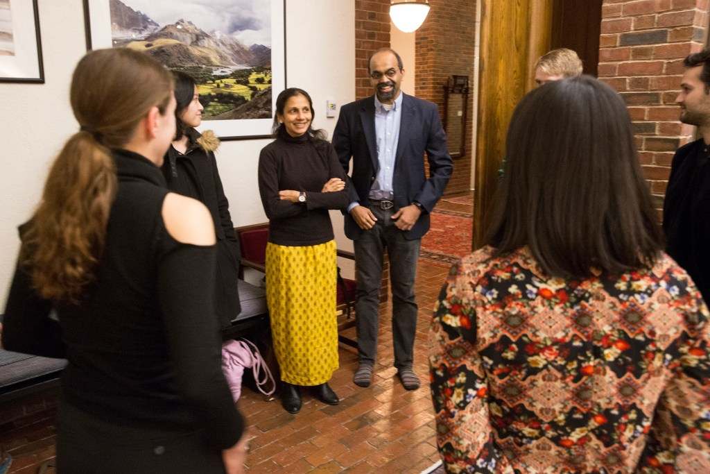 Harvard Faculty Deans L. (Maha) Mahadevan and Amala Mahadevan speak with members of the American Modern Opera Company.