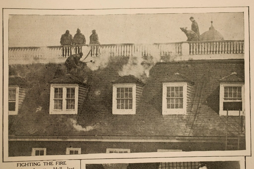 Harvard Crimson clipping shows firefighters battling Mass Hall blaze in 1924.