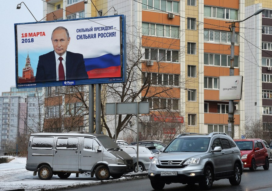 Expected to win fourth term, Putin's attention on foreign policy