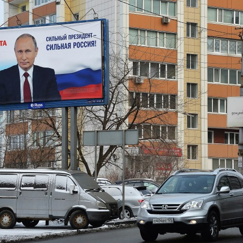 """Strong President — Strong Russia!"" declares a campaign billboard in support of Russian President Vladimir Putin ahead of the March 18 election. Putin is expected to win his fourth term easily, despite his notoriety abroad."