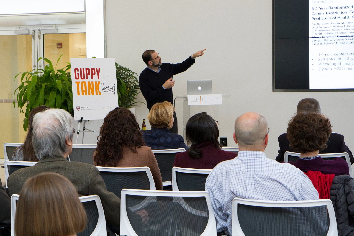 James R. Mitchell, associate professor of genetics and complex diseases at HSPH, presents on dietary restriction at Guppy Tank, where faculty get strategic guidance from a rotating panel of industry experts.