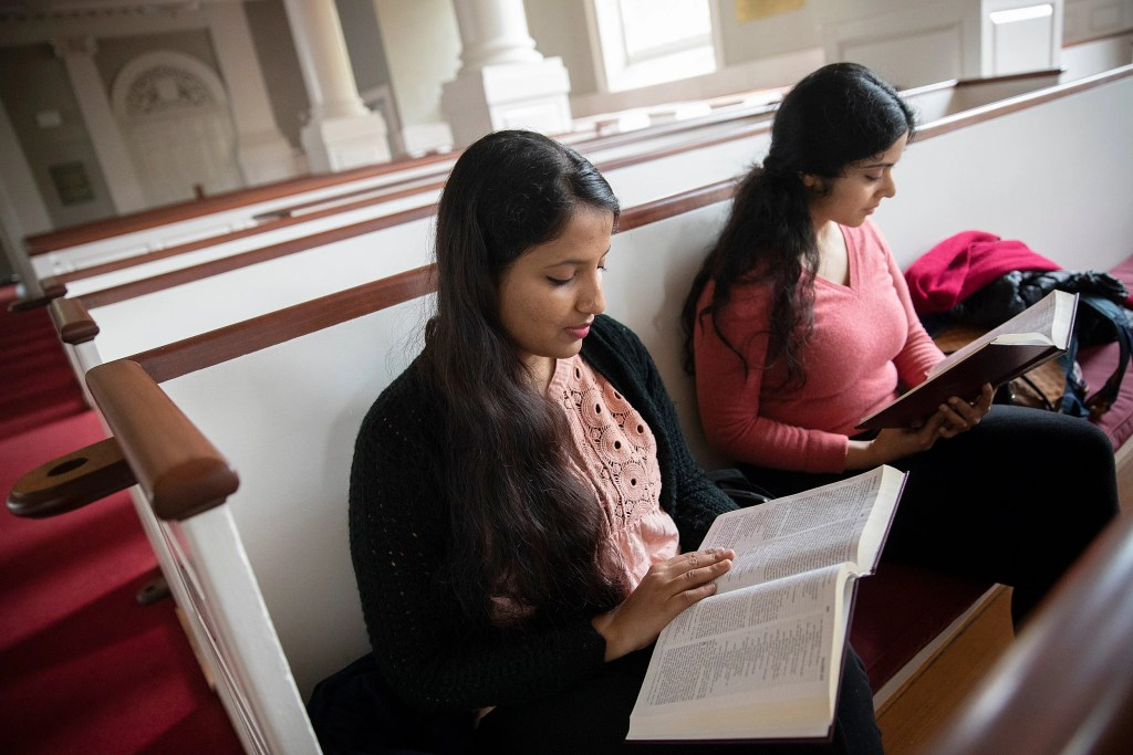Lalitha Sindhuri (left) and Anandana Kapur read the Bible.