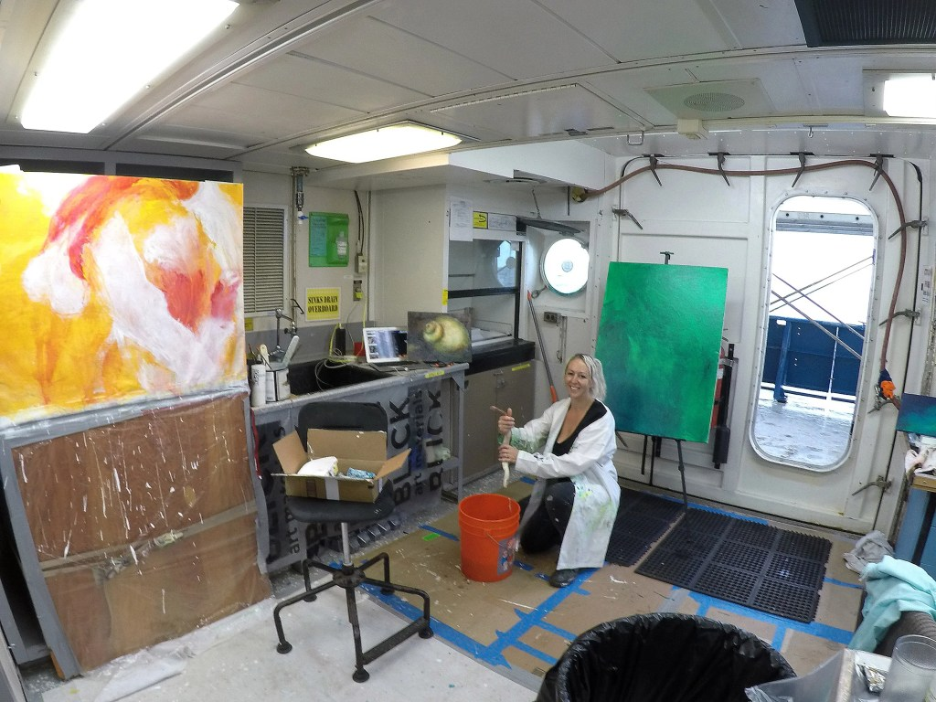 Artist Lily Simonson studies tubeworms while aboard a research vessel.