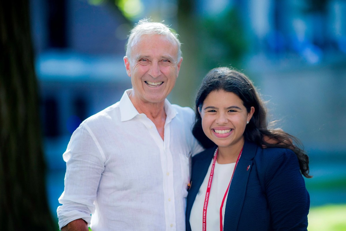 Peter Mazareas '73 and Gabriela Ruiz-Colón '16 were among a group of alumni volunteers who returned to campus on Monday to marshal First-Year Convocation.