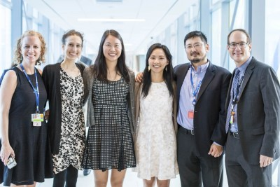 RESILIENT Co-directors Joyce Zhou and Mimi Yen Li (center) with BWH physicians Christin Price (from left), Galina Gheihman, Joji Suzuki, and Scott Weiner at the exhibit opening. Photo by Jordan Said