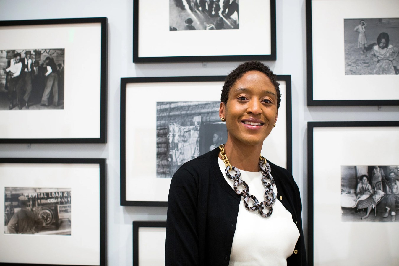 Makeda Best stands with 'Time is Now' exhibit at Harvard Art Museums.
