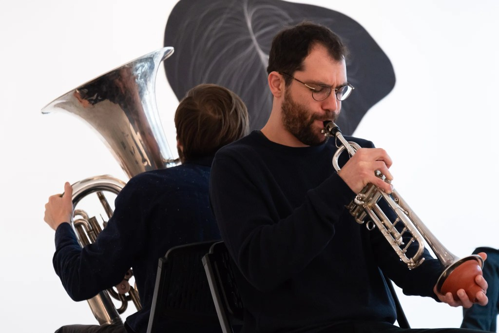 "For ""The Hanging Quilts of Measure,"" Max Murray (tuba) and Adi Snir (sax/trumpophone) turned the artist's stitches into improvisations. Kevin Grady/Radcliffe Institute"