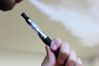 A vape pen and vape smoke