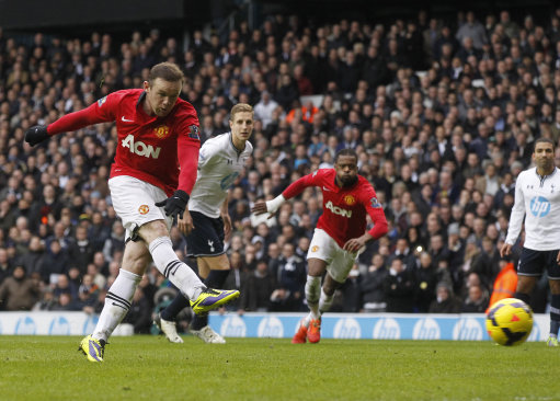 Manchester United's Wayne Rooney, left, shoots to score a penalty goal against Tottenham Hotspur during their English Premier League soccer match at White Hart Lane, London, Sunday, Dec. 1, 2013. (AP Photo/Sang Tan)