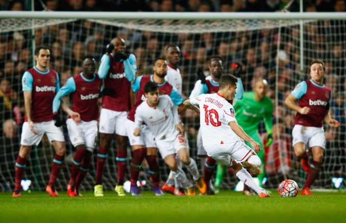 LONDON, ENGLAND - FEBRUARY 09: Philippe Coutinho of Liverpool scores their first and equalising goal from a free-kick during the Emirates FA Cup Fourth Round Replay match between West Ham United and Liverpool at Boleyn Ground on February 9, 2016 in London, England. (Photo by Clive Rose/Getty Images)