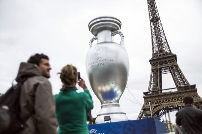 A giant replica of the Henri Delaunay trophy, awarded to the winner of the UEFA European Championship, is displayed near the Eiffel Tower on the Champs de Mars in Paris on June 23, 2013 on the sidelines of the launch of UEFA Euro 2016 brand and logo. AFP PHOTO / FRED DUFOUR (Photo credit should read FRED DUFOUR/AFP/Getty Images)