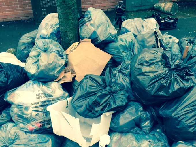 Bags of rubbish piled high in Birmingham City.