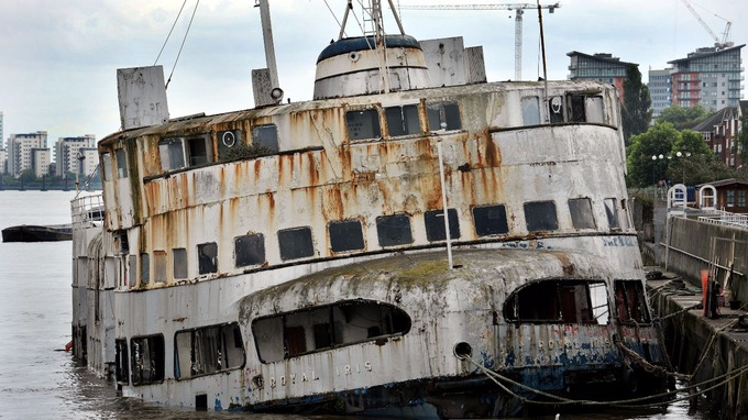 The MV Royal Iris sits in a dilapidated state whilst moored on the south side of the River Thames near to the Thames Barrier.