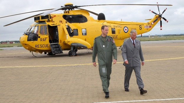 The Duke of Cambridge shows his father one of the RAF's distinctive yellow Sea King helicopters at RAF Valley on Anglesey