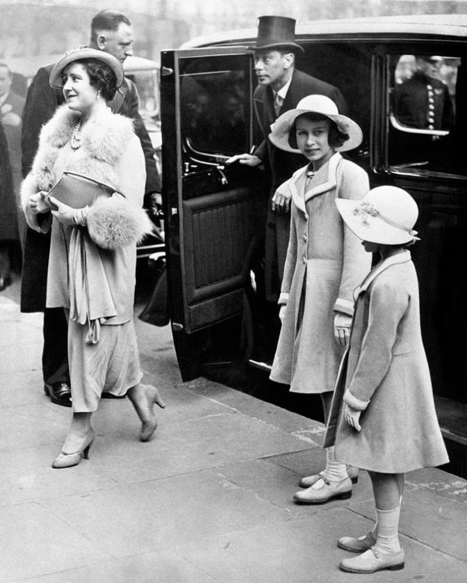 Queen Elizabeth and King George VI with Princess Elizabeth, who had not long become the heiress presumptive, and Princess Margaret in 1937