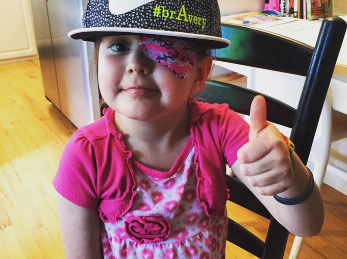 Avery Huffman posing with her thumbs up!