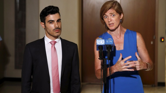Gay Syrian refugee Nahas stands with US Ambassador to the United Nations Sarah Power
