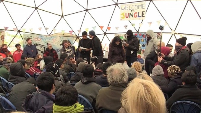 Jude Law speaks at an event at the Calais migrant 'Jungle' camp photo credit: AFP/EBU