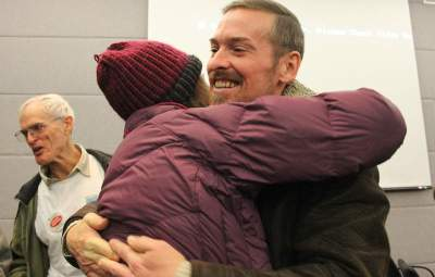 Razz Gormley with Frack Free Colorado hugging a fellow anti-fracking activist after the Boulder County Commissioners vote on Thursday