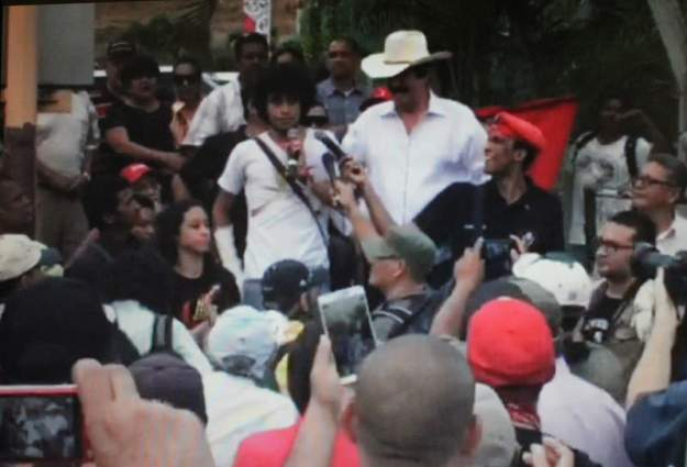 Former President Mel Zelaya (in cowboy hat) who was ousted in a 2009 US backed military coup appears at a rally in support of the student movement.