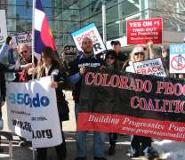 Alex Landau (center) holds a banner of his organization, the Colorado Progressive Coalition February 24,2015 to call for Governor Hickenlooper's Fracking Task Force to protect clean air and water.