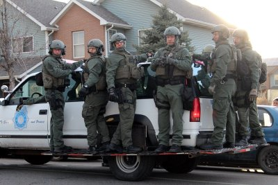 Heavily armed police arrive to the La Alma/Lincoln park on February 14, 2015 during a march in support of those affected by police violence.
