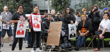 Supporters of the Nieto family and community hold signs at March 1st, 2016 rally.