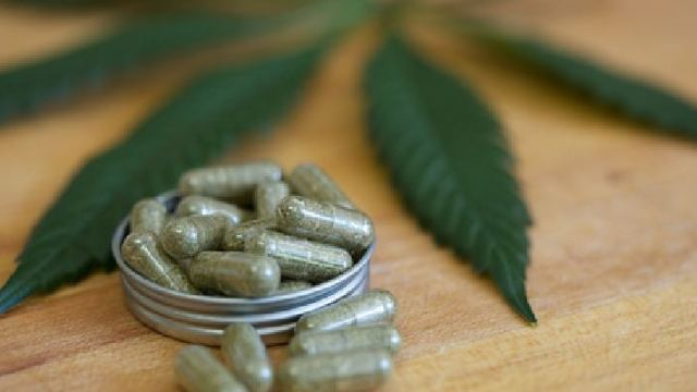 marijuana leaf and capsules
