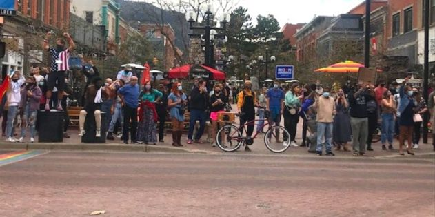 A large crowd gathers in celebrate on Boulder's Pearl Street mall.
