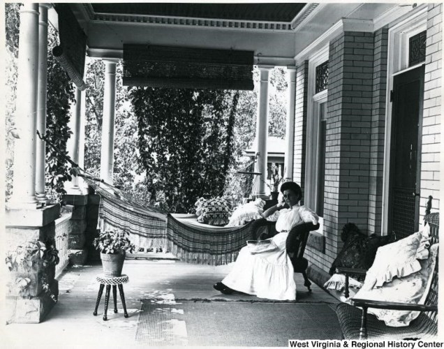 Photo of a woman on a large and well-furnished porch