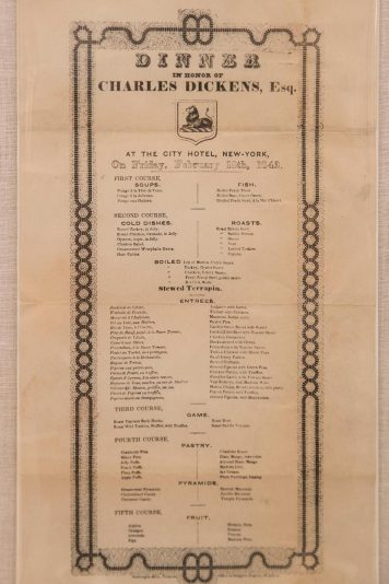 """Menu for a dinner in honor of Charles Dickens' tour of America, includes """"stewed pigeons with green peas."""""""
