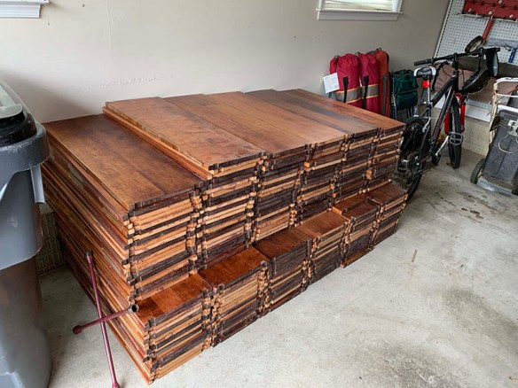wooden bookshelves in 6 stacks about 3 feet high next to each other in a storage area