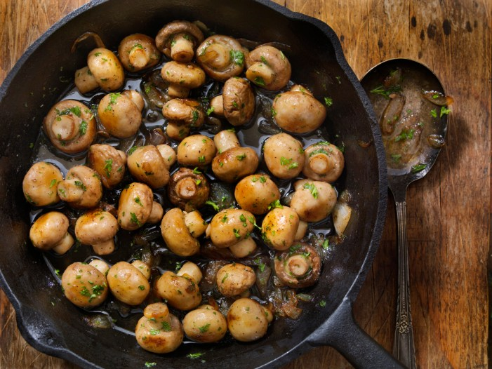 Garlic Mushrooms with Onions in a cast iron pan