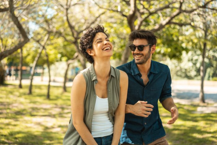 Couple happily walking in park