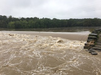 Photo of high water and debris in the Upper Potomac River.