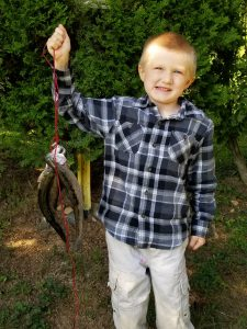 Photo of boy with rainbow trout