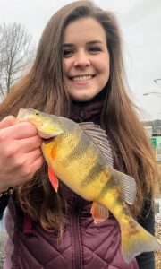 Photo of girl with yellow perch