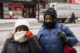 Puffer coats pull through for Lillian Smith, Acadia Square, and Lynn Gordon, Taylor, who spent their afternoon wandering downtown bundled up in matching scarfs and hats. (Mallory Hughes / Medill)
