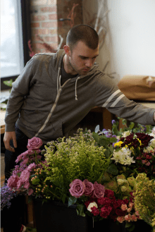 Hayden Regina, the floral designer at the Flowers for Dreams is responsible to create specific themes of bouquets with varied flowers every day. (Jin Wu/Medill)