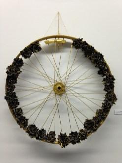"Lindsay Cogan. ""Ride Until the Wheels Fall Off."" Innertube roses, bicycle wheel, paint, hot glue. $250 (Shanley Chien/Medill)"