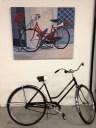 "Top: Greg Riley. ""Red Bicycle."" Acrylic on canvas; Bottom: Matthew Rachman. ""Black Bike."" 1971 Schwinn Breeze (Shanley Chien/Medill)"